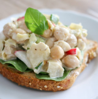 Artichoke chickpea salad is a fresh crisp treat. It is great for work or school lunches. Eat it in a bowl, lettuce cup, or on gluten-free bread. www.veganglutenfreelife.com/artichoke-chickpea-salad/