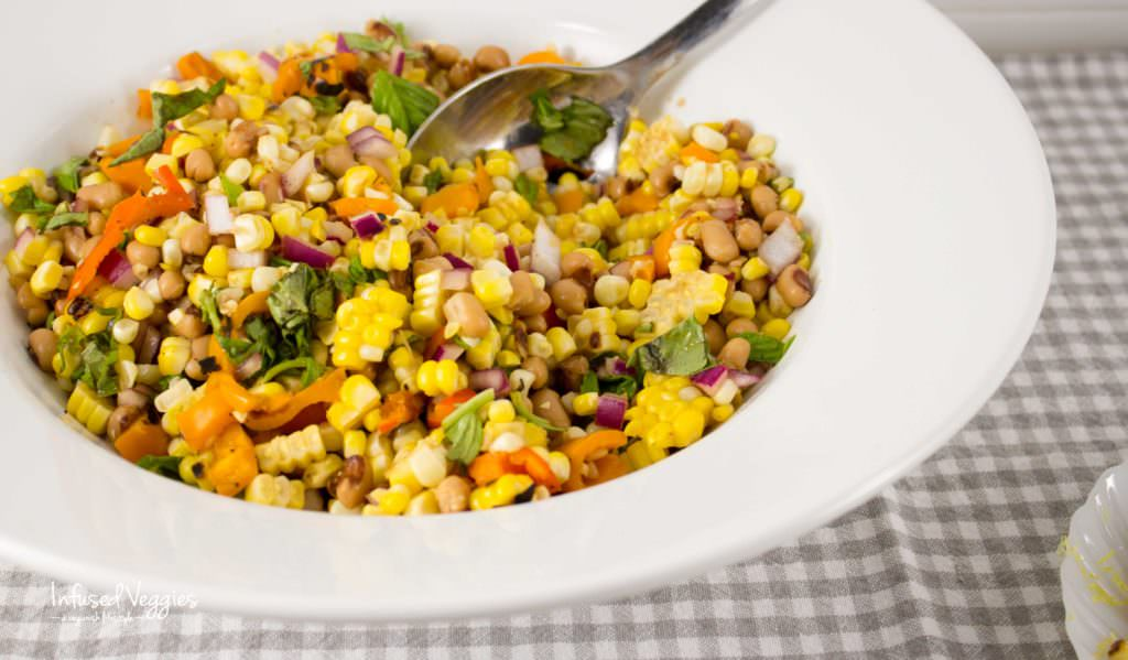 Grilled corn salad with rainbow vegetables is a colorful recipe bursting with summer flavors. Vegan and Gluten free picnic goodness.infusedveggies.com
